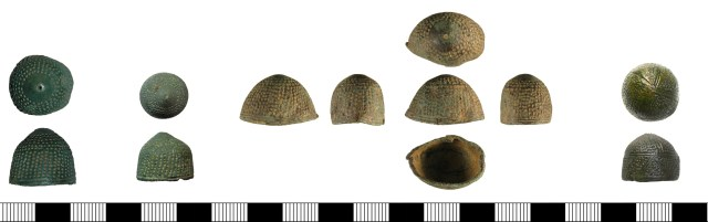 Thimbles of probable 14th-century date. Left to right: BH-433F18, OXON-413F44, WMID-A9590D, PUBLIC-3E590B. Note the grooved decoration on PUBLIC-3E590B.