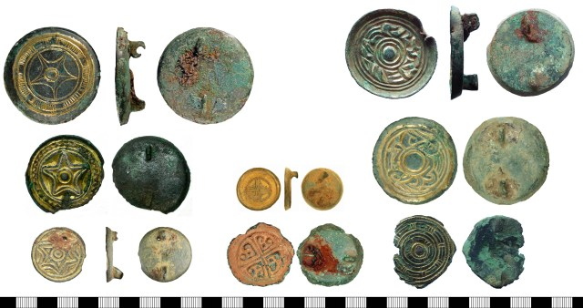 Cast saucer brooches, showing a range of sizes and motifs. Left: five-point and six-point stars (WMID-CE6945, SUR-FF9815, SF-EB7350). Centre: simple cross (KENT-30F985) and floriate cross (SOMDOR-EB4897). Right: two Style I designs (SUR-1C82C9 and WILT-52B85F) and 'basketwork' (SUR-FE99C1).