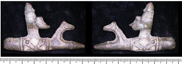 Curious object showing a helmeted Viking holding a drinking horn (LEIC-EEF651)