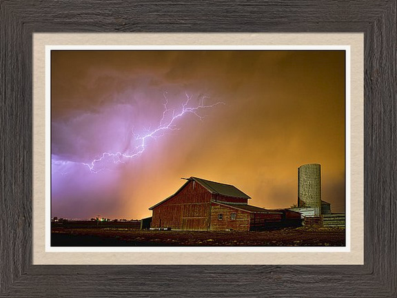 Watching The Storm From The Farm Framed Print