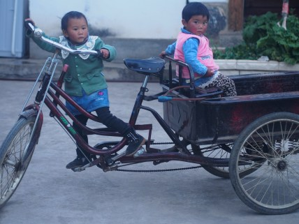 The smaller girl was put on the trike by her mother, a bit uncertain to start she ended up loving it.