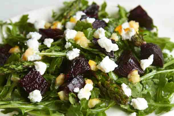 Salad with charred lemon dressing, grilled beets and asparagus, and goat cheese