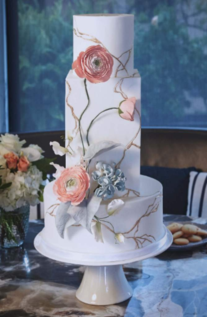 Kintsugi wedding cake with sugar ranunculus and flowers for modern wedding in Toronto Canada