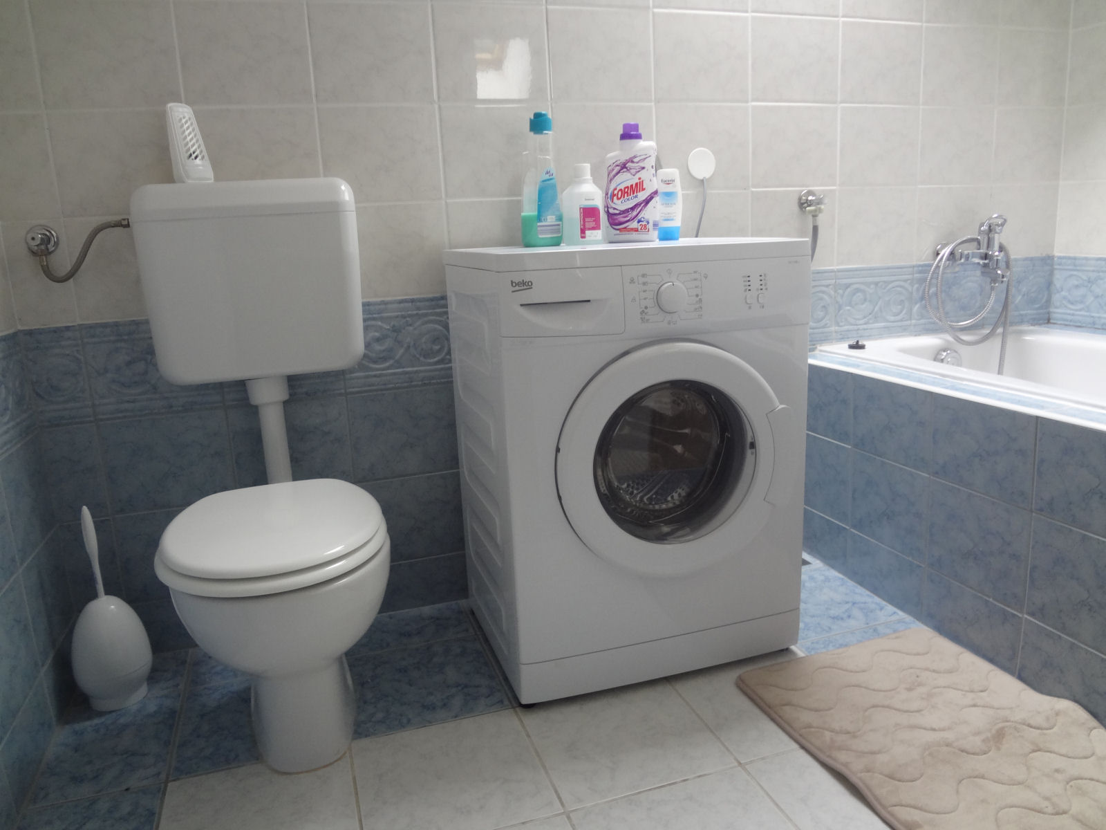 A New Washing Machine In The Bathroom For Our Guests