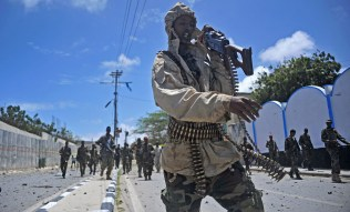 Somali security forces patrol the scene of a suicide car bomb blast on Aug. 30, 2016. in Mogadishu. Al-Shabab jihadists aligned with al-Qaeda claimed responsibility for the blast.(Mohamed Abdiwahab/AFP/Getty Images)