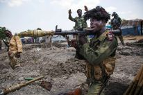 Soldiers of the Sudan People Liberation Army (SPLA) celebrate while standing in trenches in Lelo, outside Malakal on Oct. 16, 2016.