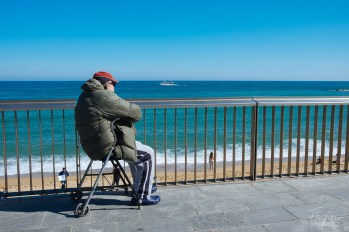 Guy looking at the sunny beach in Barcelona