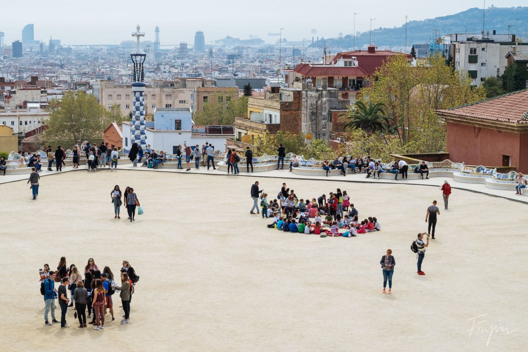 People are enjoying the view over Barcelona