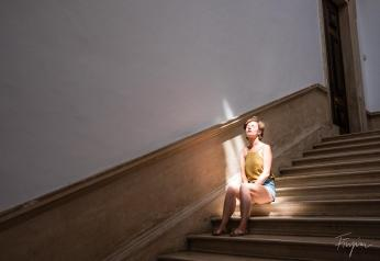 girl sitting sun stairs