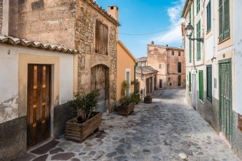 An alley with orange houses in a small village on the island of mallorca