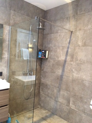 After: creating a spacious feel with a glass shower wall.