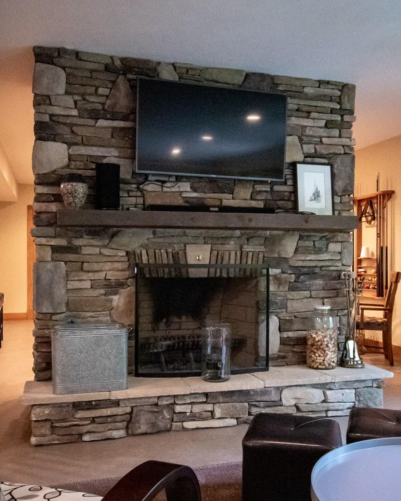 Finished Basement Stone Fireplace