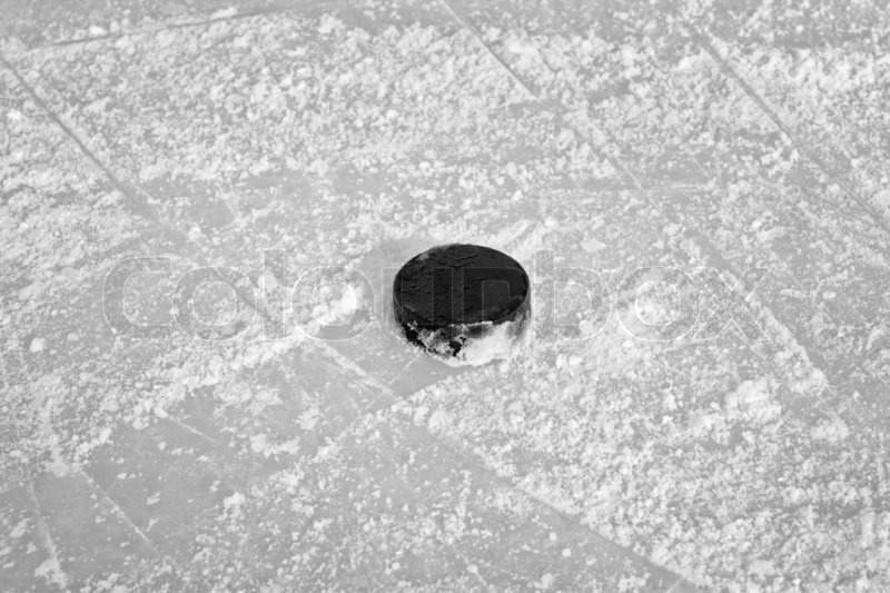 1458642-black-hockey-puck-on-ice-rink