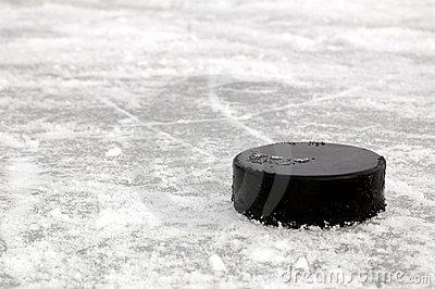 black-hockey-puck-ice-rink-8016165