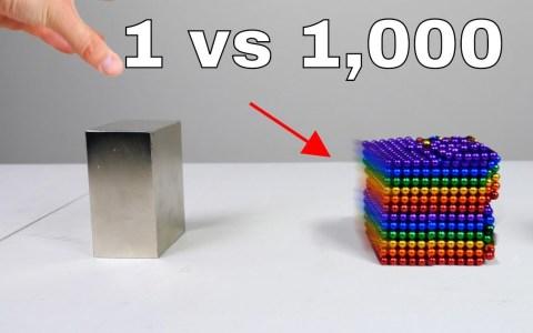 Esta es la influencia que tiene un enorme bloque de neodimio sobre 1000 pelotas de neodimio.