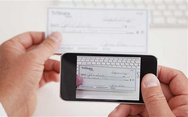 Mobile cheque payments to be delayed by another year