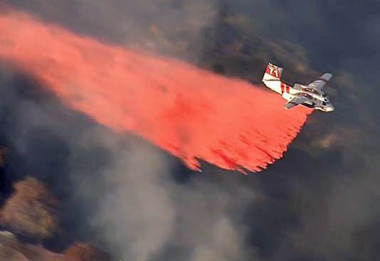 Tanker 71 dropping on Madison Fire in Monrovia. Screen grab from ABC7 video.