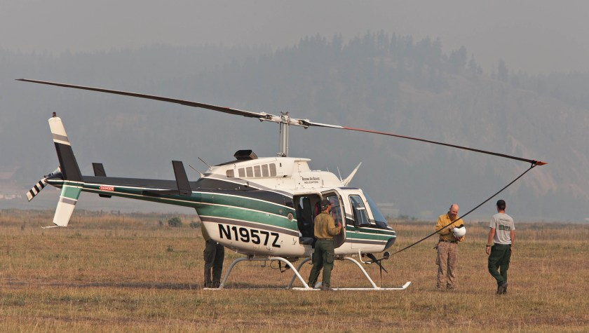 Members of Swan Valley Helitack from the Caribou-Targhee National Forest prepare for a mission to the Carpenter Road Fire near Colville, WA August 25, 2015.