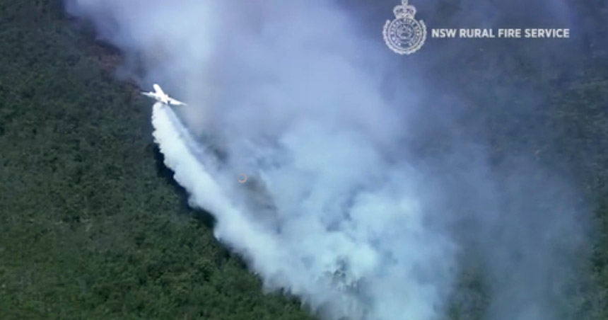 A DC-10 is dropping an alternative to retardant on wildfires in Australia