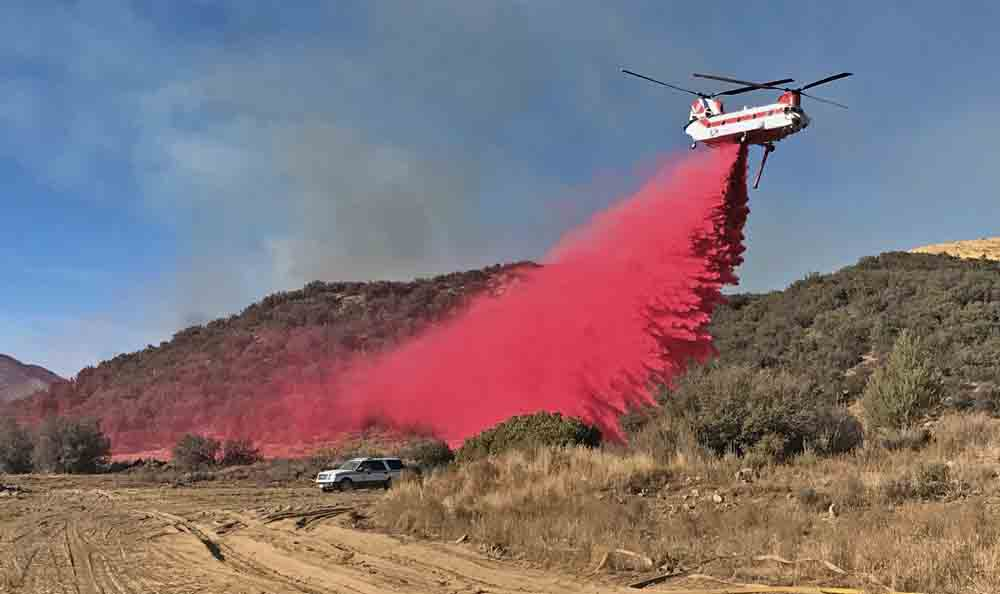 Helicopter dropping retardant Thomas Fire