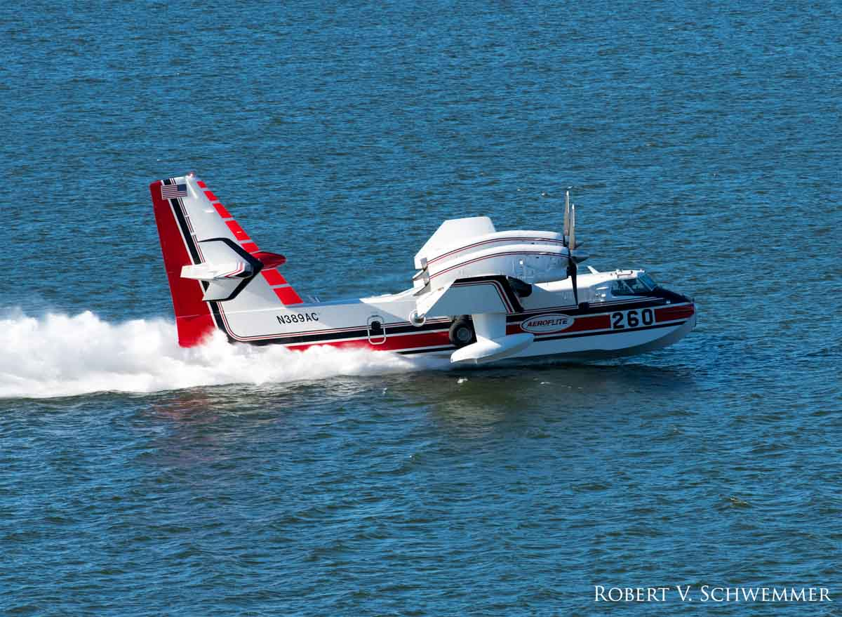 CL-415's scooping water at Castaic Lake