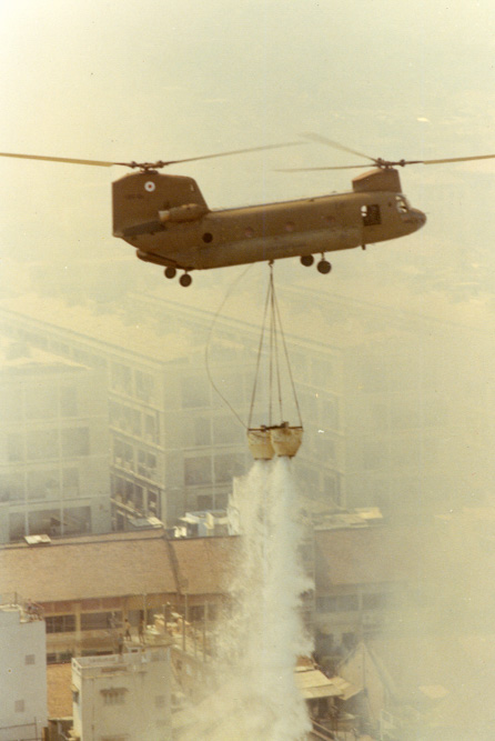 Chinook Vietnam helicopter water bucket structure fire 1970