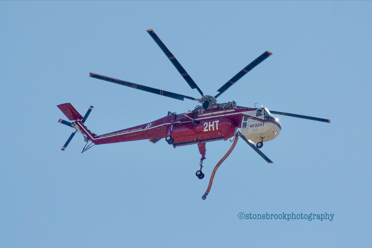 Photos of helicopters refilling at the Saddle Ridge Fire