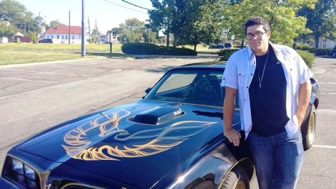 Nicky Sindora, 20, of Trenton with his  restored '77 Trans Am Special Edition.