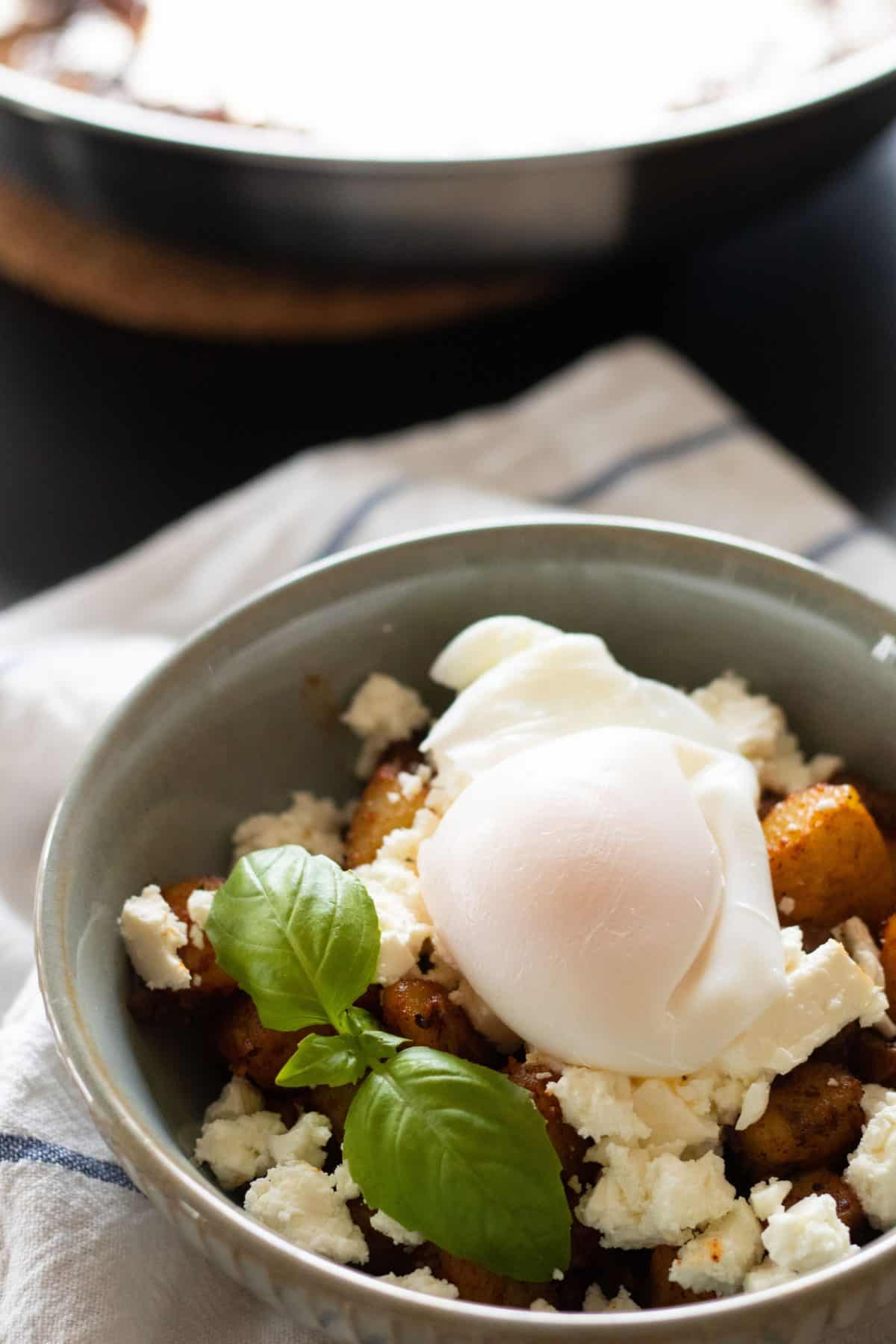 Fried Potatoes Breakfast Bowl with Feta Cheese & Poached Egg