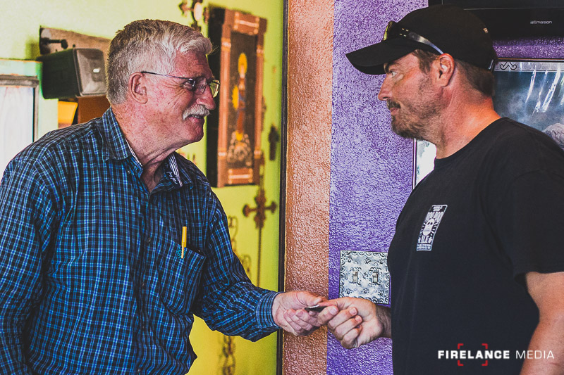 Jim Grasky handing out Greenside Training patches to student graduate Rob Anderson of US Palm