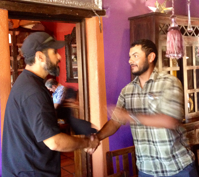 "Freddy Osuna presenting me with the ""Alpha Wolf"" shirt. Photo courtesy of David Reeder"