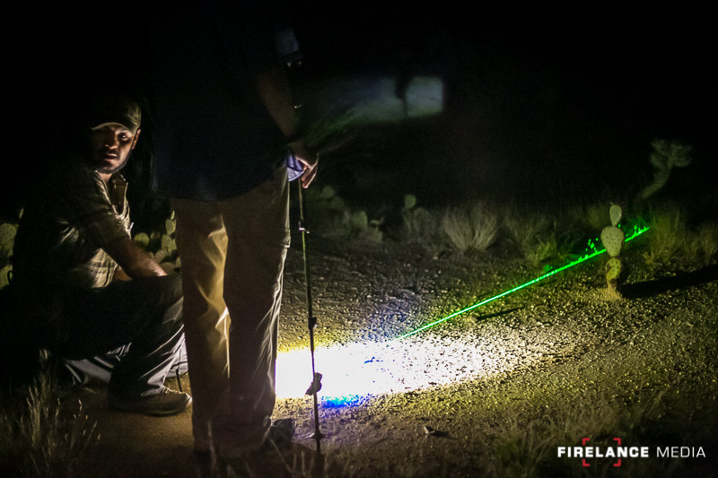 Freddy Osuna demonstrating the use of a green laser to determine track locations at night
