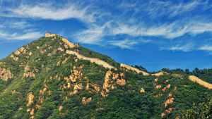 green hills under alto cirrus clouds