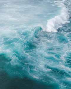 stormy blue sea in sunlight