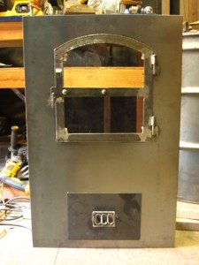 cob cottage masonry heater door