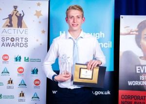 winner receiving an award at an event