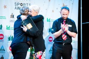 lady receiving an award at an event