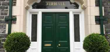 Green front door at Firhall Guest House in the Scottish Highlands