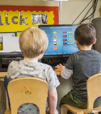 2 children at computer desk 3