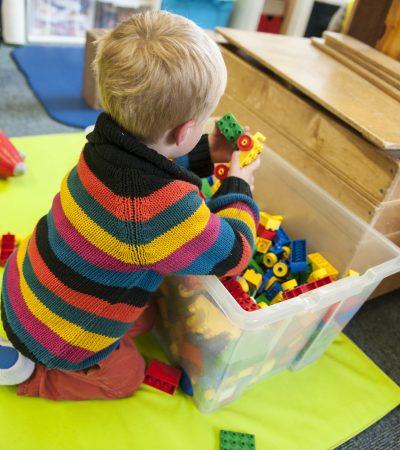 boy playing with lego