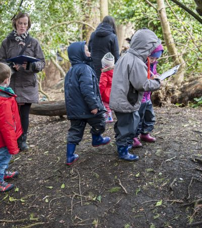 child and parents on a wild wood hunt