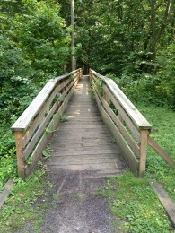 Barclay Farmstead bridge over the river and through the woods.
