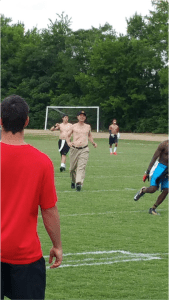 Jim Harbaugh runs a Michigan training camp shirtless.