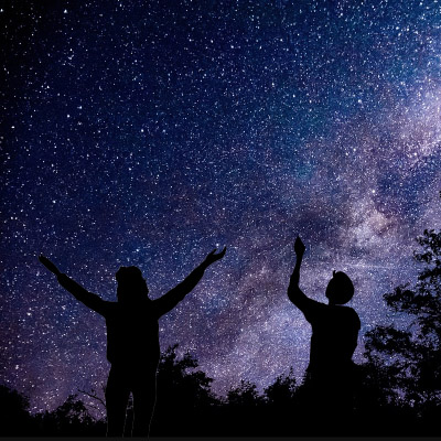 People looking at the stars