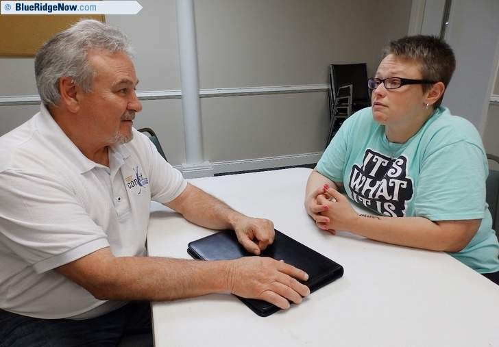 Craig Halford of First Contact talks with recovering meth addict Melia Huntley at Mud Creek Baptist Church Thursday. Huntley, who used drugs for 20 years and has been clean for six months, spoke out about her experience and the scourge of drug addiction. BETH DE BONA/TIMES-NEWS