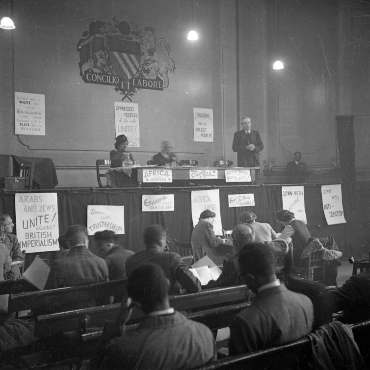 10th November 1945: John McNair, General Secretary of the ILP (Independent Labour Party) addresses the first Pan-African Congress in Manchester. Also on the stage is Amy Jacques Garvey, the second wife of Marcus Garvey. Original Publication: Picture Post - 3024 - Africa Speaks In Manchester - pub. 1945 (Photo by John Deakin/Picture Post/Getty Images)