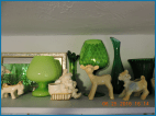 Collection of ceramic animal and green glass vases