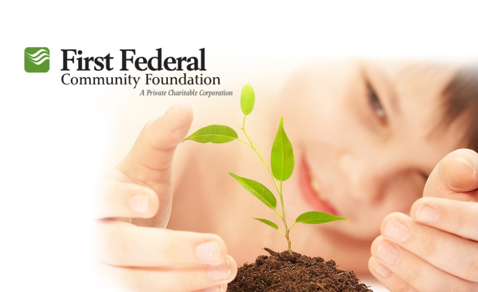First Federal Community Foundation welcome page with logo, photo of child with plant