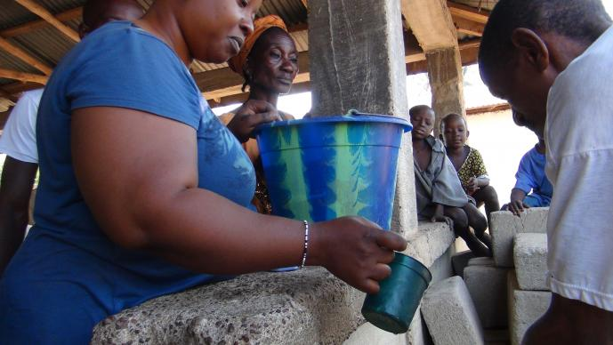(2015 file photo by Jan Snider, United Methodist Communications) At a community gathering in Tilorma village, Kenema district, Sierra Leone, hand-washing became routine after the outbreak of Ebola. The virus has killed nearly 4,000 people in Sierra Leone.