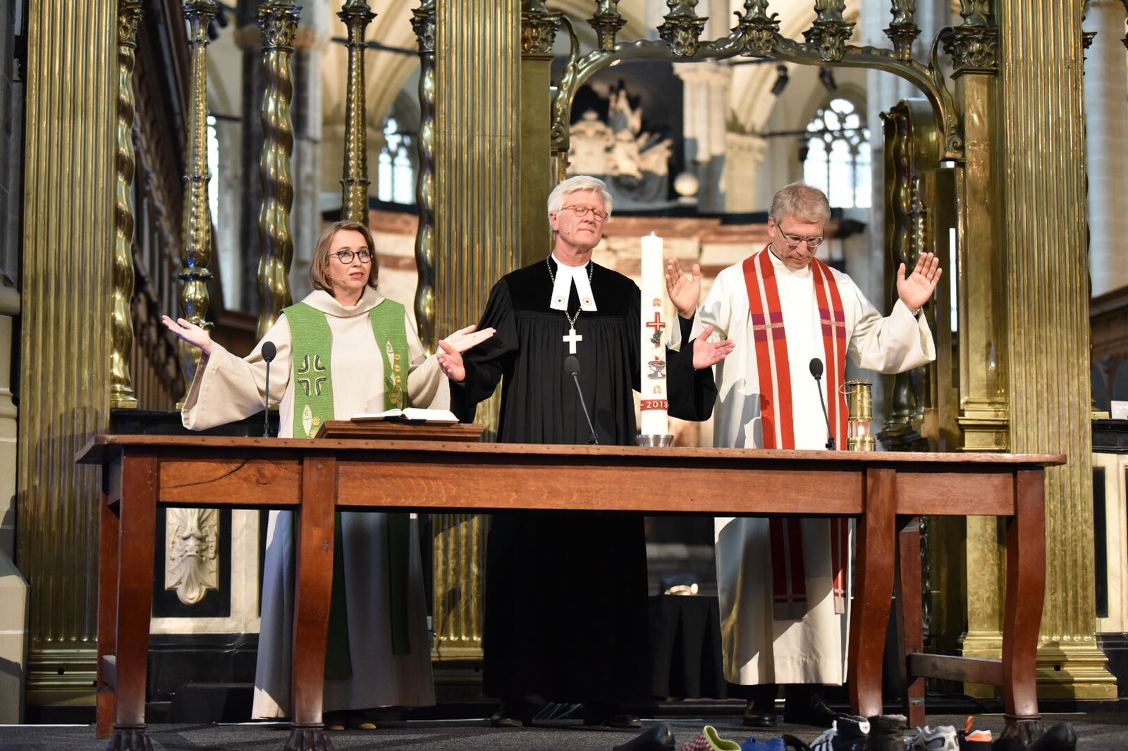 Rev.-Margarithe-Veen-Bishop-Dr-Heinrich-Bedford-Strohm-and-Rev.-Dr-Olav-Fykse-Tveit-in-ecumenical-prayer-service-at-the-Nieuwe-Kerk-in-Amsterdam.-Photo-Albin-HillertWCC